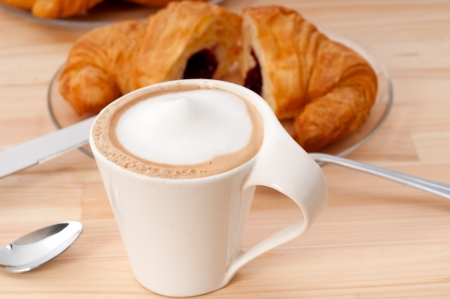 fresh croissant french brioche and coffee typical traditional Italian breakfast photo