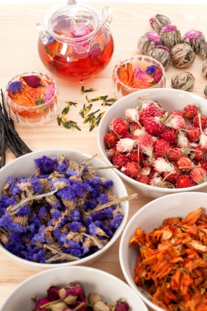 Herbal natural floral tea infusion with dry flowers ingredients photo