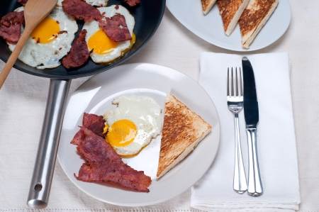eggs sunny side up with bacon and toast typical english breakfast photo
