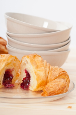 fresh baked croissant French bche filled with berries jam Stock Photo - 15377917