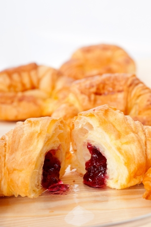 fresh baked croissant French bche filled with berries jam Stock Photo - 15377918