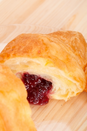 fresh baked croissant French bche filled with berries jam Stock Photo - 15377923