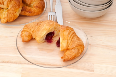 fresh baked croissant French bche filled with berries jam Stock Photo - 15377926