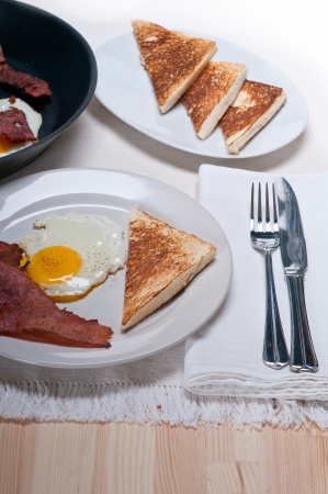 eggs sunny side up with bacon and toast typical english breakfast Stock Photo - 15377929