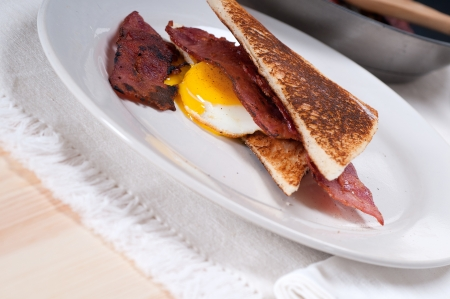 eggs sunny side up with bacon and toast typical english breakfast Stock Photo - 15377927
