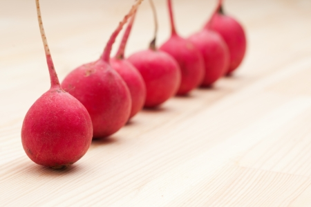 fresh red raw  raddish over pine wood table closeup Stock Photo - 15377905