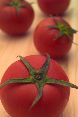 fresh ripe tomatoes over pine wood table Stock Photo - 16216811