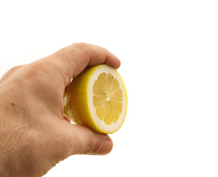 fresh ripe lemon cutted in half hold in hand closedup Stock Photo - 16216809