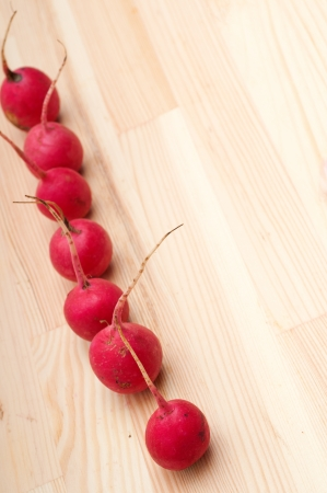 fresh red raw  raddish over pine wood table closeup Stock Photo - 16216846