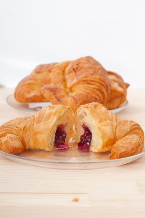 fresh baked croissant French brioche filled with berries jam Stock Photo - 16453109