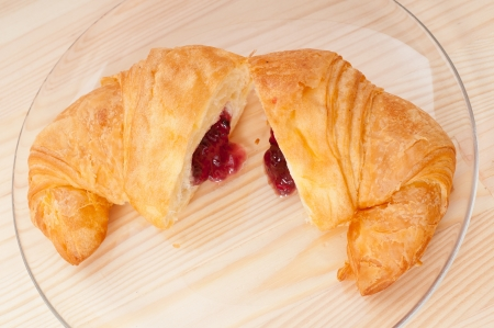 fresh baked croissant French bche filled with berries jam Stock Photo - 16453119