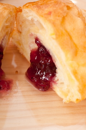 fresh baked croissant French bche filled with berries jam Stock Photo - 16453120