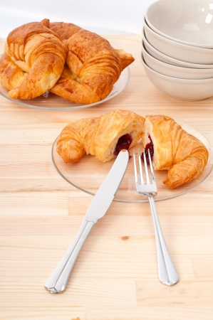 fresh baked croissant French bche filled with berries jam Stock Photo - 16453115