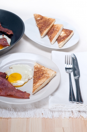 eggs sunny side up with bacon and toast typical english breakfast Stock Photo - 16453116