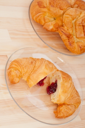 fresh baked croissant French bche filled with berries jam Stock Photo - 16662011