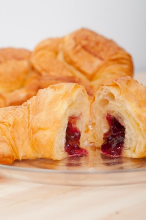 fresh baked croissant French bche filled with berries jam Stock Photo - 16661927