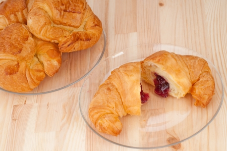 fresh baked croissant French bche filled with berries jam Stock Photo - 16662062