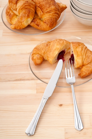 fresh baked croissant French brioche filled with berries jam Stock Photo - 16662017
