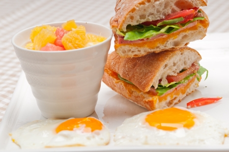 fresh ciabatta panini sandwich with eggs tomato lettuce Stock Photo - 17006782