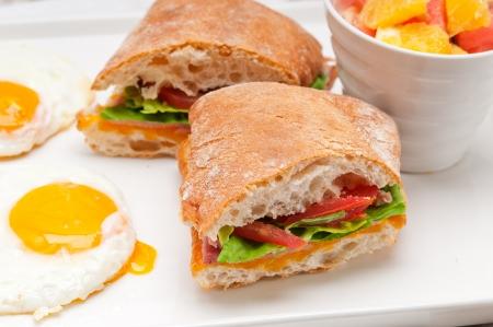 fresh ciabatta panini sandwich with eggs tomato lettuce Stock Photo - 17006803