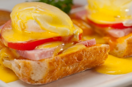 fresh eggs benedict on bread with tomato and ham Stock Photo - 17006781