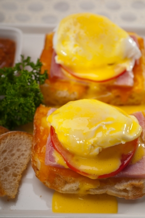 fresh eggs benedict on bread with tomato and ham photo
