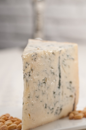 piece of Italian gorgonzola cheese fresh cut and pinenuts photo