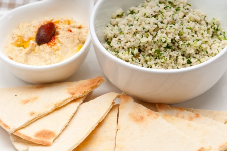 fresh traditional arab taboulii couscous with hummus Stock Photo - 17006837