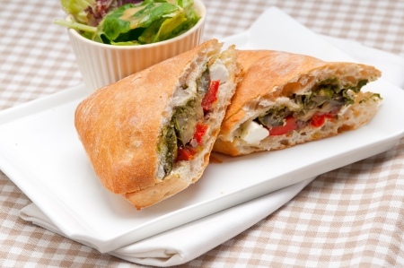 Italian ciabatta panini sandwichwith with vegetable and feta cheese photo
