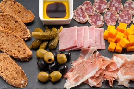 assorted fresh cold cut platter Italian appetizer photo
