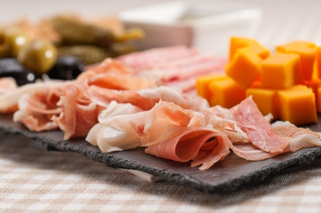 assorted fresh cold cut platter Italian appetizer Stock Photo