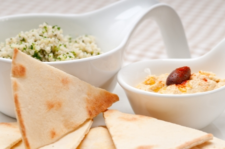 kuskus: fresh traditional arab taboulii couscous with hummus Stock Photo