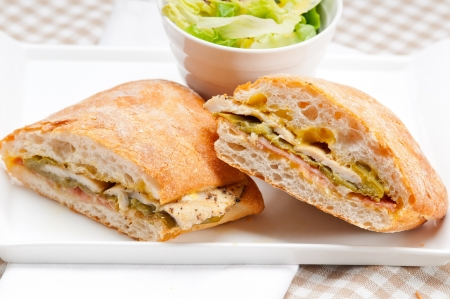traditional Italian ciabatta panini sandwich chicken vegetables and aioli photo