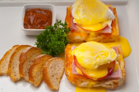 fresh eggs benedict on bread with tomato and ham Stock Photo - 17105591