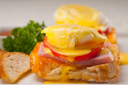 fresh eggs benedict on bread with tomato and ham Stock Photo - 17105564