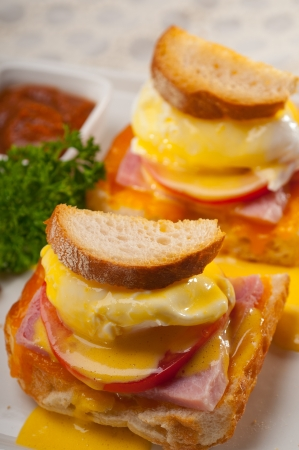 fresh eggs benedict on bread with tomato and ham Stock Photo - 17105577