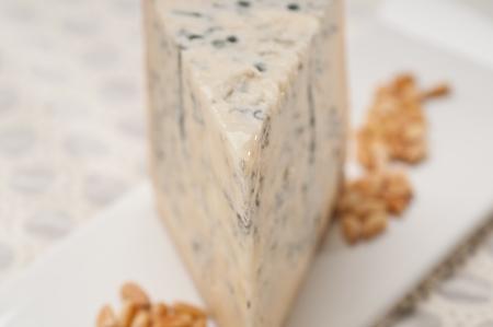piece of Italian gorgonzola cheese fresh cut and pinenuts Stock Photo - 17105552