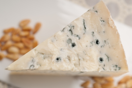 piece of Italian gorgonzola cheese fresh cut and pinenuts Stock Photo - 17105553