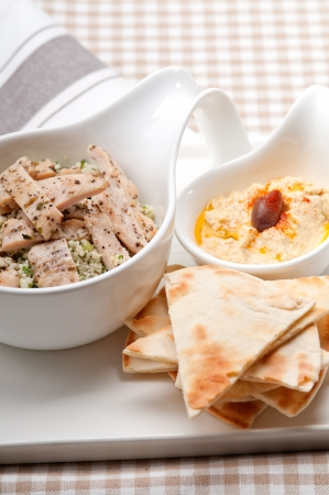 fresh traditional arab chicken taboulii couscous with hummus Stock Photo - 17105569