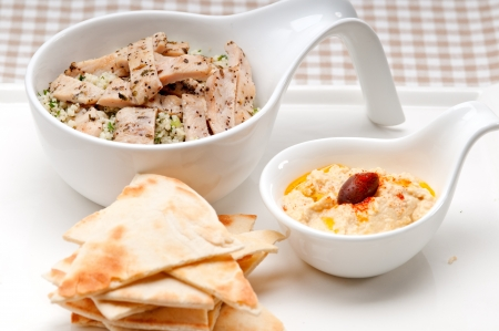 fresh traditional arab chicken taboulii couscous with hummus Stock Photo - 17105561