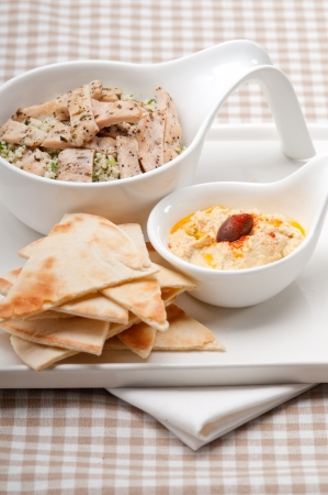 kuskus: fresh traditional arab chicken taboulii couscous with hummus