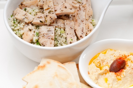 fresh traditional arab chicken taboulii couscous with hummus Stock Photo - 17105558