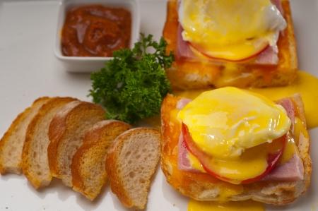 fresh eggs benedict on bread with tomato and ham Stock Photo - 17349859