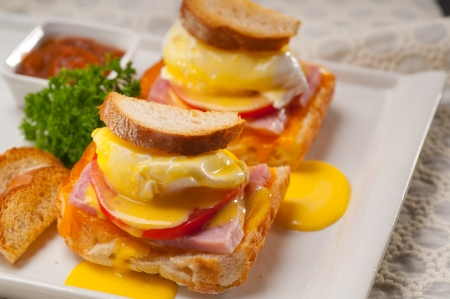 fresh eggs benedict on bread with tomato and ham Stock Photo - 17349861