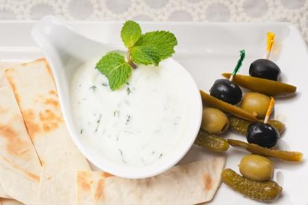 fresh Greek Tzatziki yogurt dip and pita bread and pickels Stock Photo - 17349874