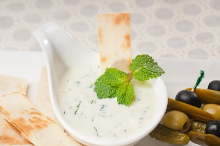 fresh Greek Tzatziki yogurt dip and pita bread and pickels photo