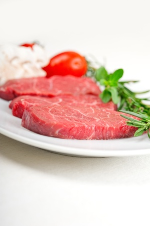 raw fresh Kobe Miyazaky beef with rosmary and marjoram Stock Photo - 17846674