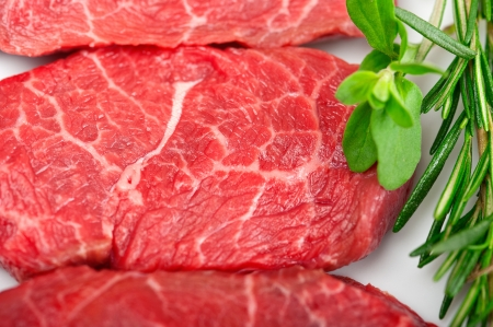 raw fresh Kobe Miyazaky beef with rosmary and marjoram