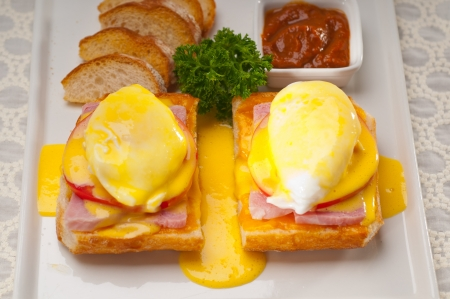 fresh eggs benedict on bread with tomato and ham Stock Photo - 17846724