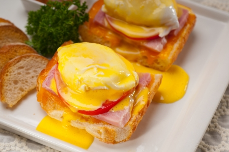 fresh eggs benedict on bread with tomato and ham Stock Photo - 17846725